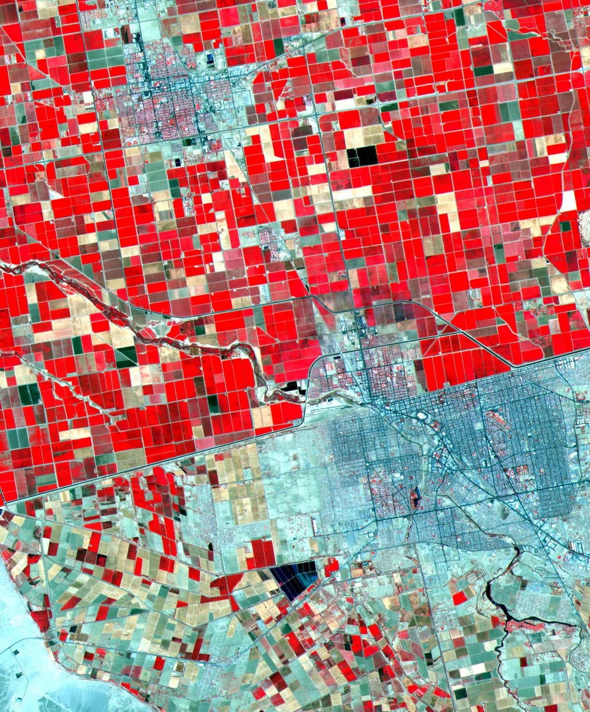 mexican border wall california farms nasa aster satellite image