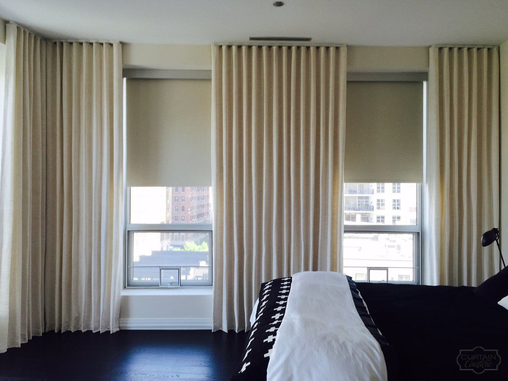 Stationary Ripple Fold Panels and Blackout Roller Shades by Alexandra Kaehler Design & Curtain Couture
