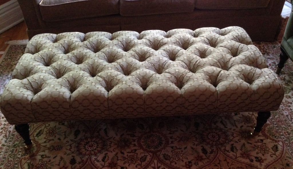 Deep tufted ottoman by Curtain Couture