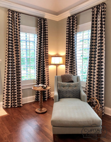 "These luxurious abstract pattern stationary drapery panels ""WOW"" the living room. Designed by Studio Gild & fabricated by Curtain Couture."
