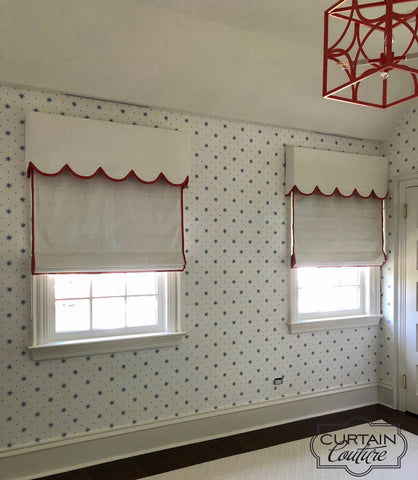 White linen accents with ruby red decorative trim, flat roman shades and scalloped edge valances, create a playful ambiance in  the Girl's Room. Designed by Sally Brown and fabricated by Curtain Couture.