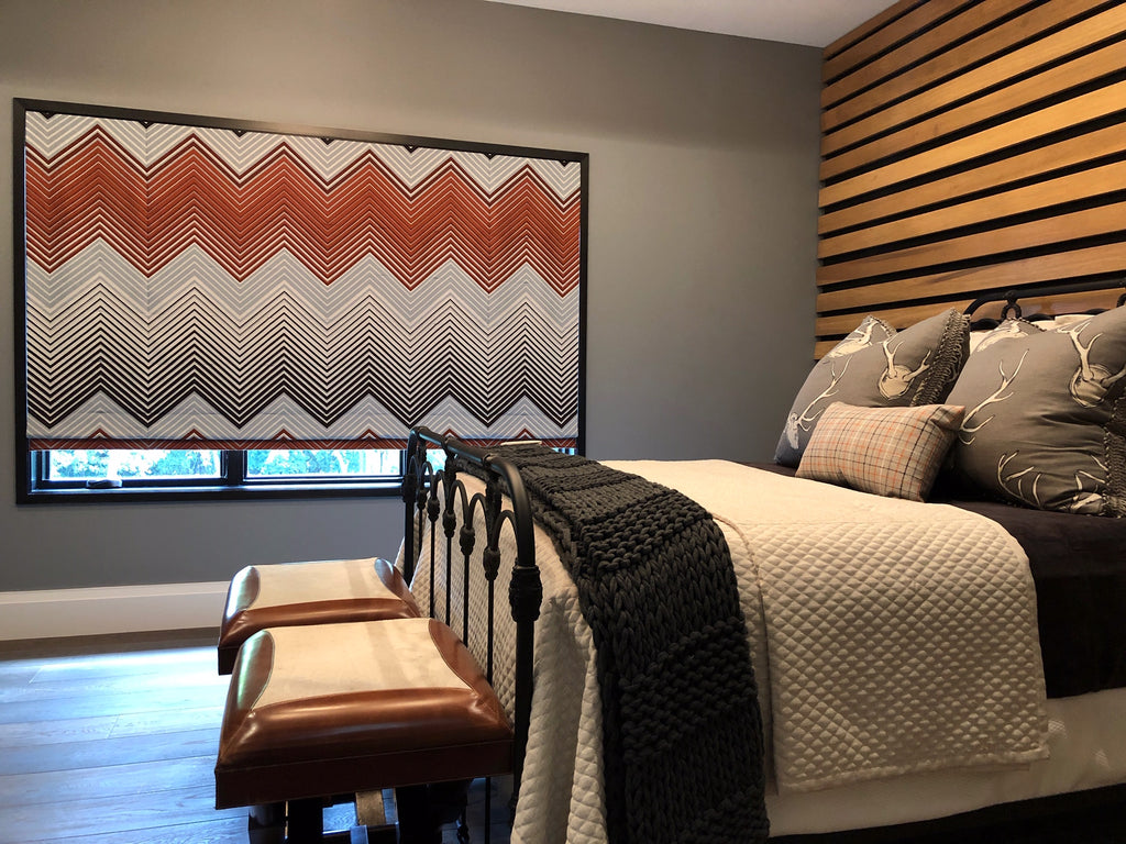 Contemporary Geometric Motorized Roman Shade sizzles in this bedroom. Designed by Kelly Stevenson & fabricated by Curtain Couture