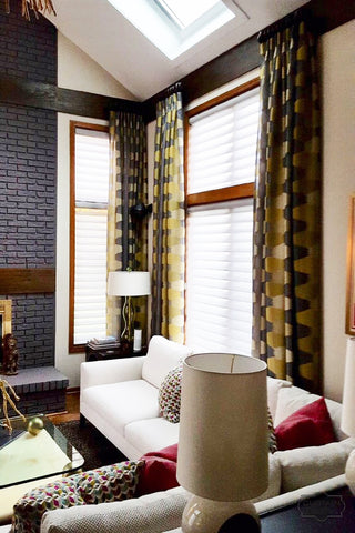 Combination of Decorative Panels and Silhouette Shades by Lisa Wolfe Designs and Curtain Couture