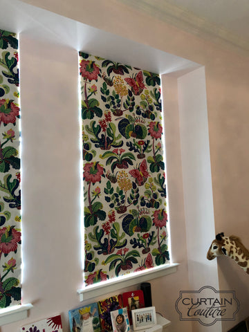 Nature galore theme roman shades, with blackout lining in the girl's room. Designed by M&M Designs and fabricated by Curtain Couture.