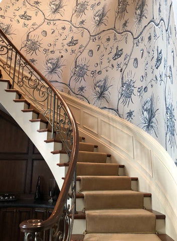 Beautiful monumental scale wallpaper from Zoffany. The modernized wallpaper is inspired by an 18th century English toile. Perfectly complementing the tall & curve staircase.