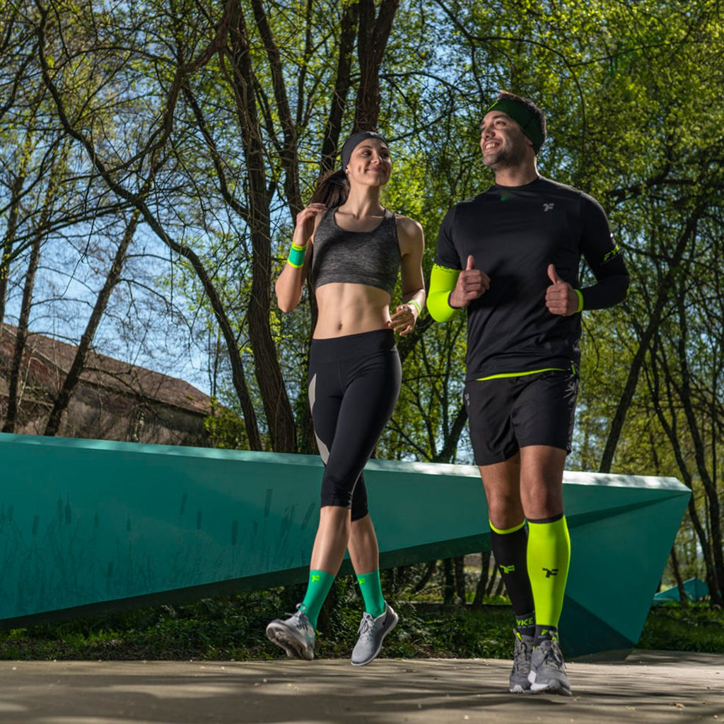 Couple Running Sporting Fyke Performance Apparel