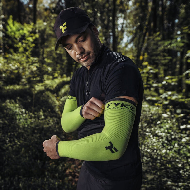 Athlete preparing for trail running with fyke compressive sleeves