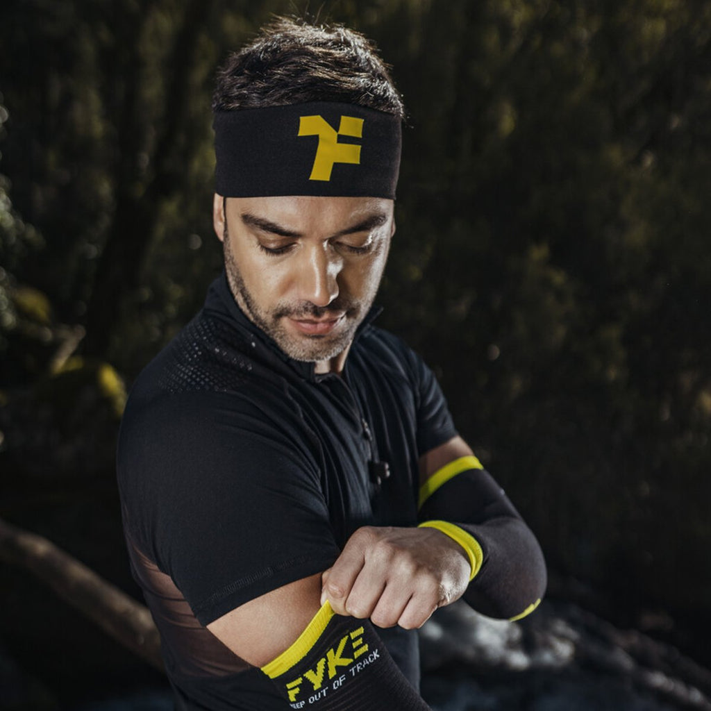 Athlete preparing for running with fyke compressive sleeves