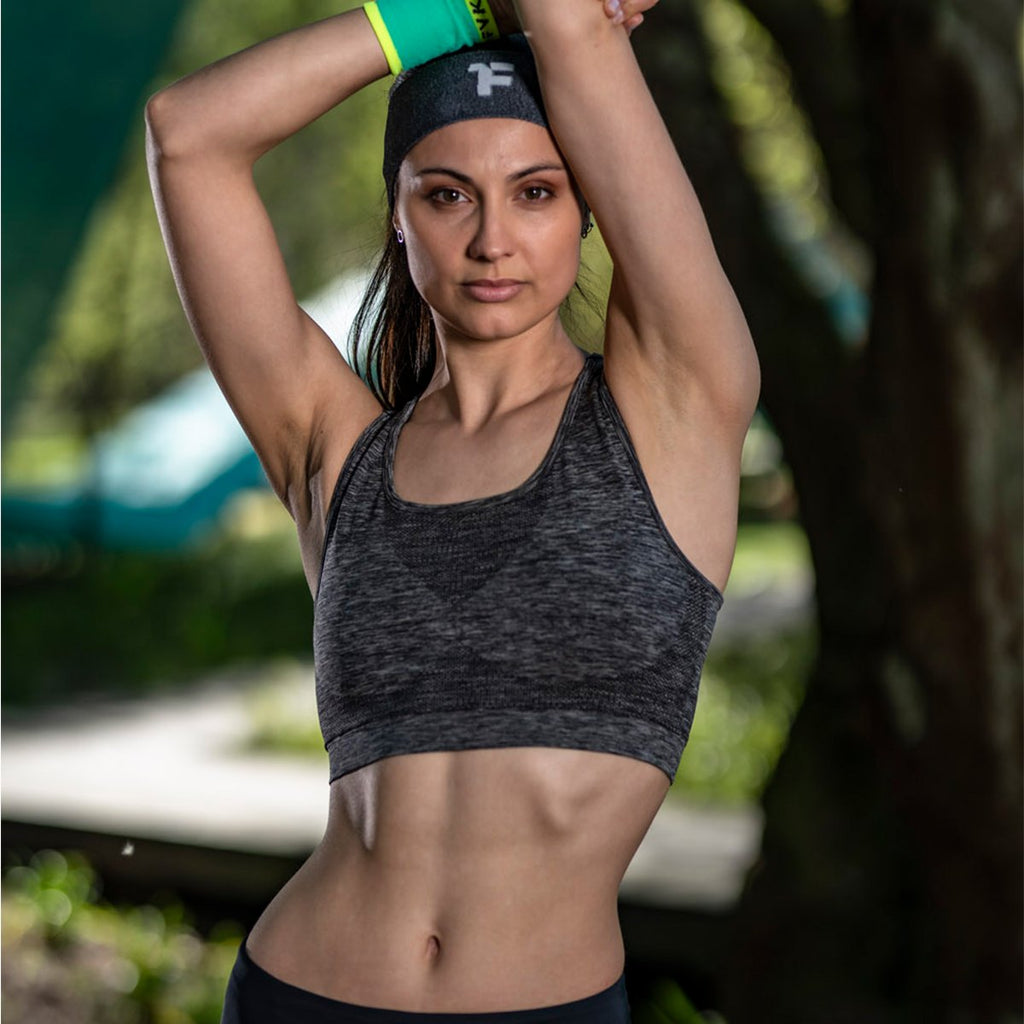 Woman stretching in the park with fyke headband