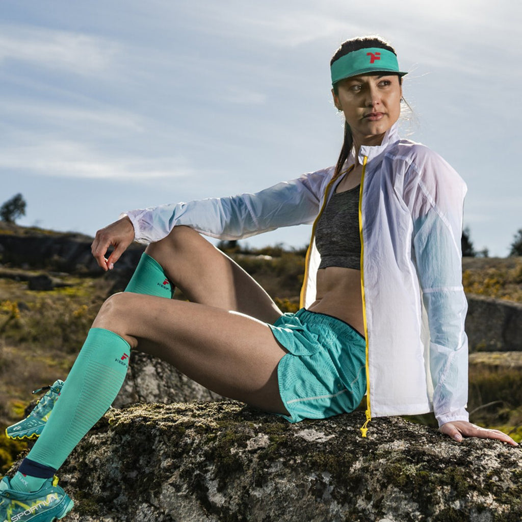 Woman Outdoors with fyke headwear and compressive calves