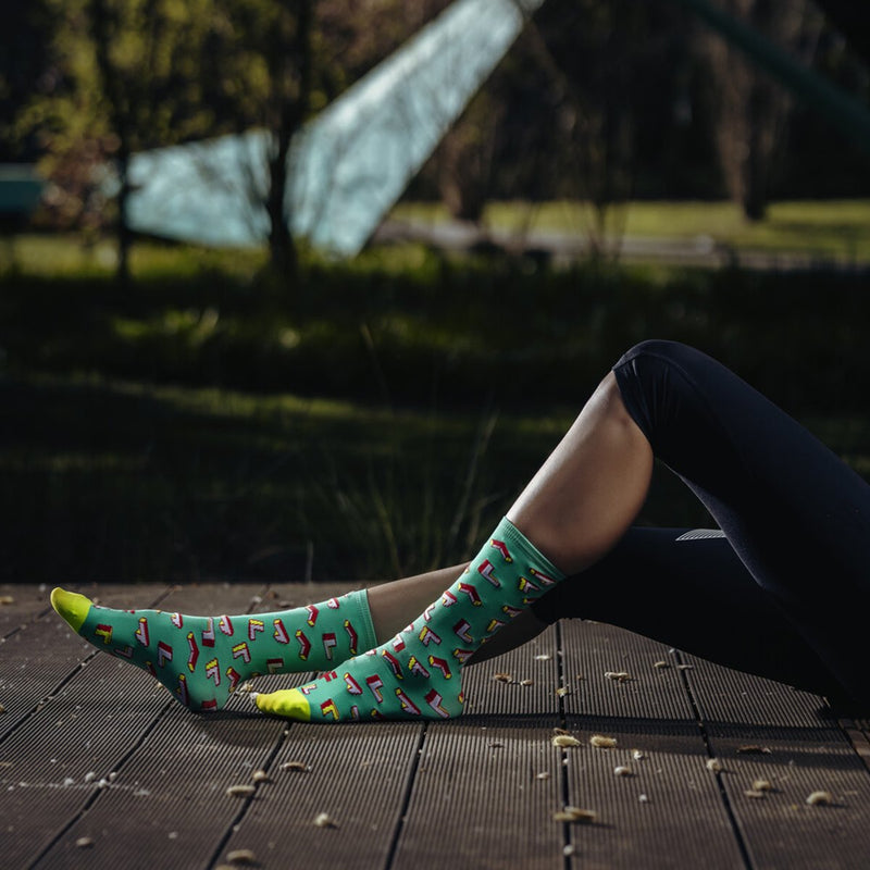 Woman with funny fyke green arrows socks
