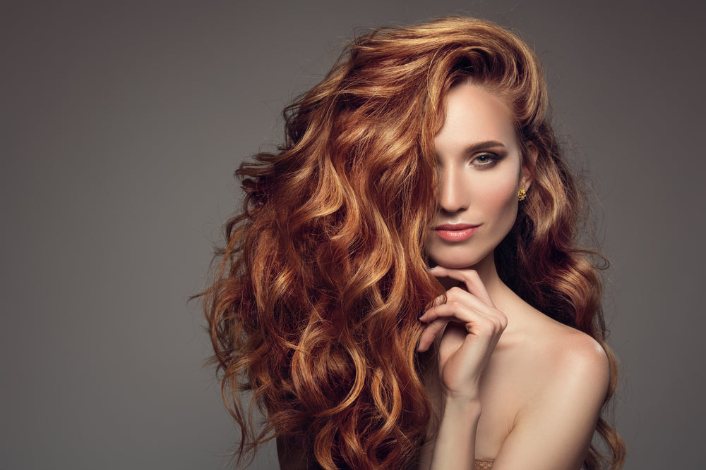 woman with thick curly red hair