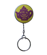 "Retractable ID Badge Reel - ""We're All Mad Here"" Yellow"