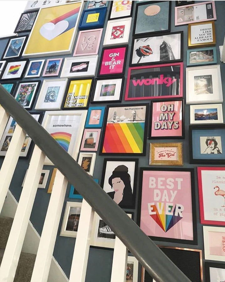 Stairwell gallery wall at Emma from Flawsome home with our Magic print