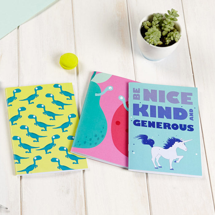 Dinosaur, apple and pear and unicorn notebooks