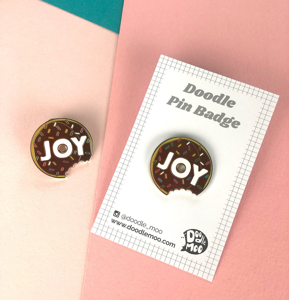 JOY Doughnut enamel pin designed by Doodlemoo