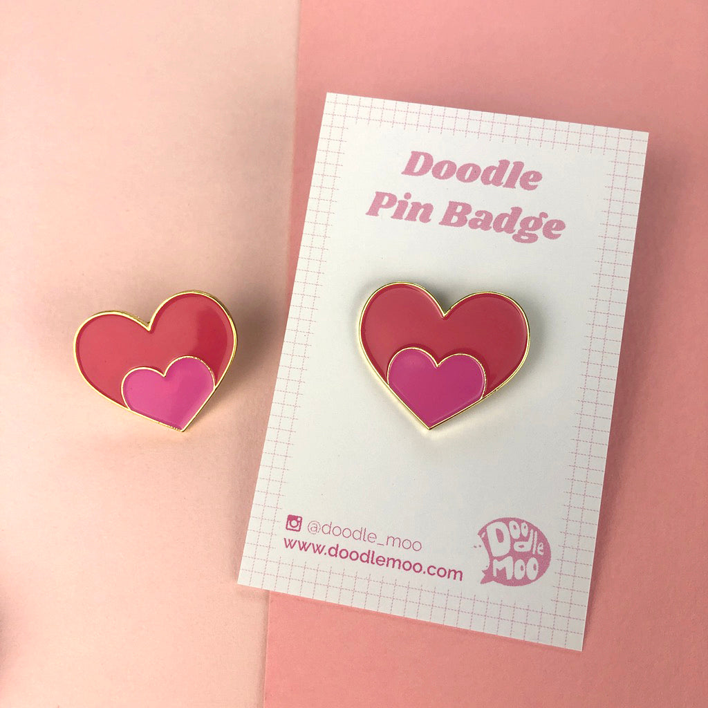 Heart Enamel Pin in pink designed by Doodlemoo