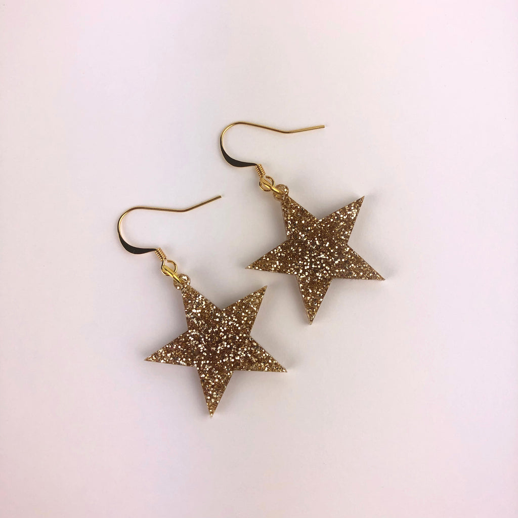 Star earrings made of glitter gold acrylic