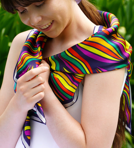 Model is wearing colourful silk scarf