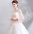Trumpet Sleeves Illusion Neck Wedding Dress with Flower Lace Appliques
