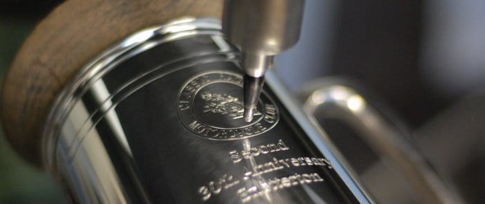 A tankard being engraved with a personalised message