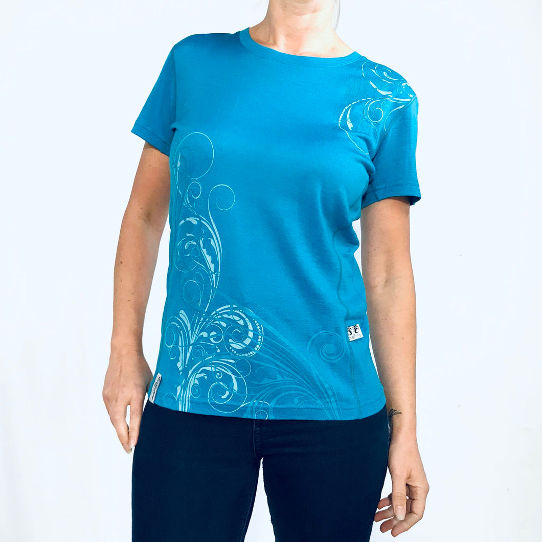 Women's blue merino tee with koru print. www.kiakaha.co.nz