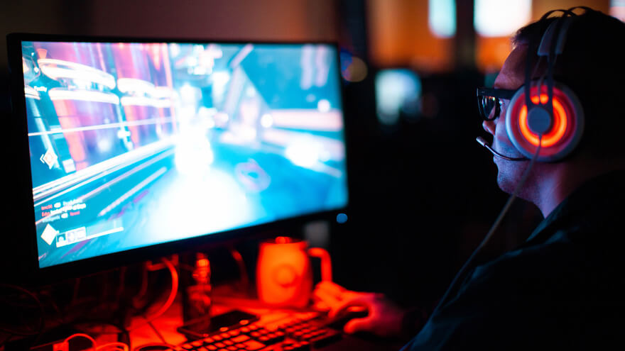An esports player during a professional game session with teammates