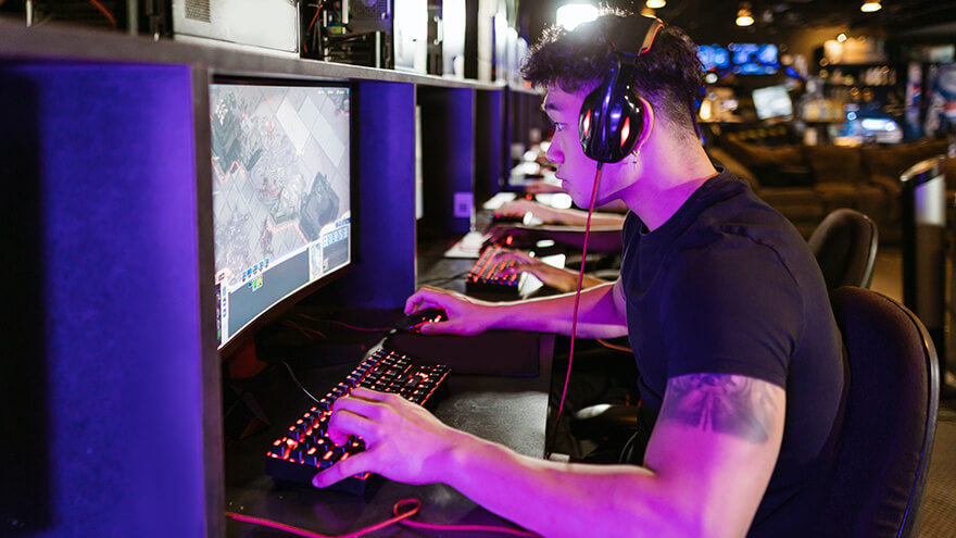 Gaming headphones as a part of a video game setup for esports tournament