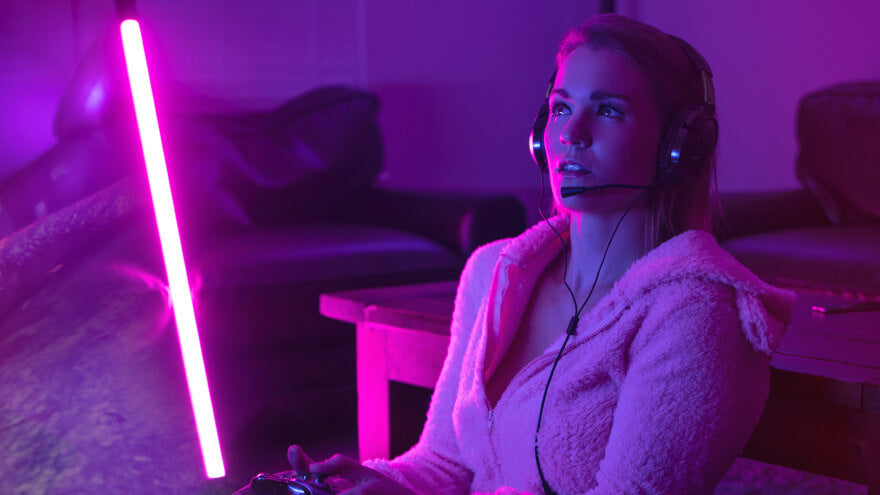 A women playing online games with her gaming headset