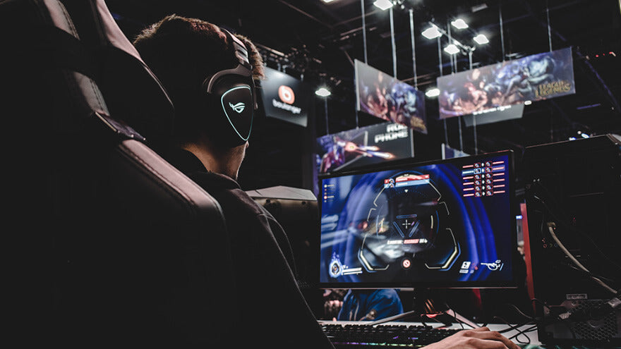 A pro gamer playing at video games with esports teammates