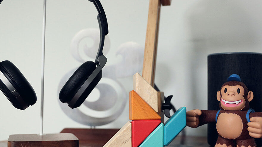 A headphone on a holder in a geek room