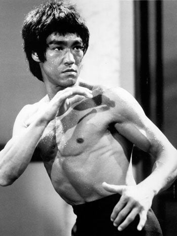 bruce lee with his iconic pose in black and white