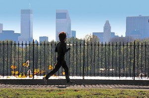 Running in front of a city skyline