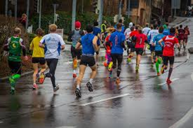 Group of runners on wet street