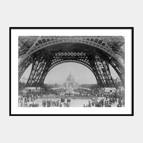 Photographic print of the Eiffel Tower, 1889, in black and white with a white border and the poster is framed