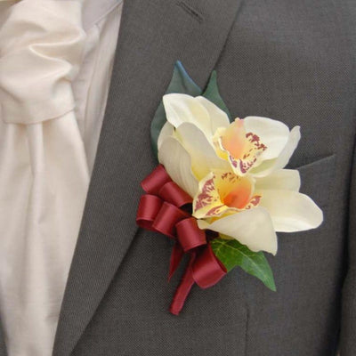 Grooms Double Silk Ivory Orchid Buttonhole with Burgundy Bow