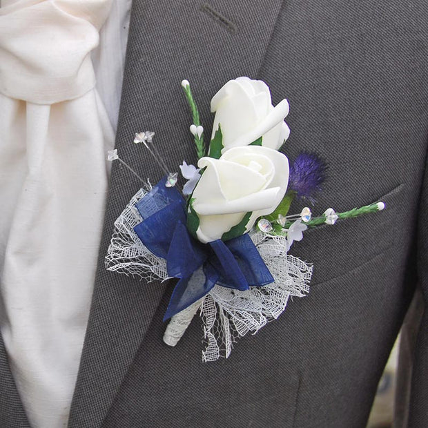 Grooms Ivory Rose, Thistle, Heather & Crystal Buttonhole with Navy Ribbon