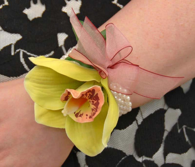 Green Silk Orchid & Burgundy Bow Pearl Band Wrist Corsage