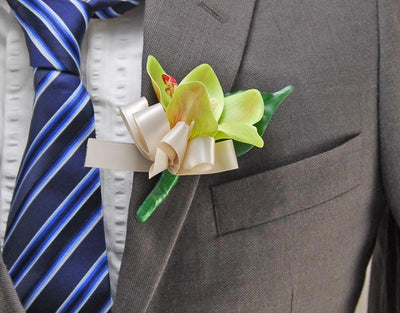 Green Silk Orchid & Satin Bow Wedding Guest Buttonhole