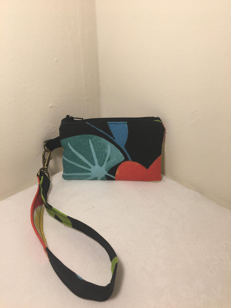 Zipper Pouch / Wristlet: Black background with blue and orange flowers with cream colored silk lining