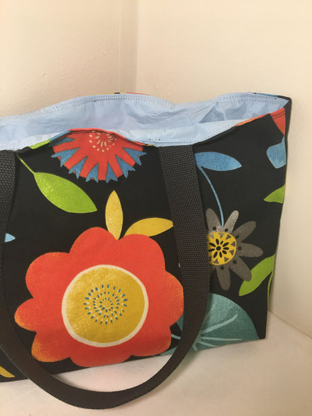 Tote Bag: Black background with orange, blue and yellow flowers with pale blue lining