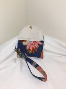Wrist Pouch: Multicolored floral on blue with cream cotton lining