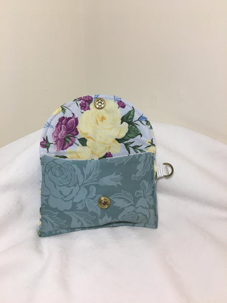 Wrist Pouch: Sage green floral pattern with yellow & purple floral lining