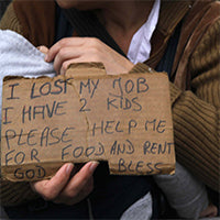 homeless woman and child with sign