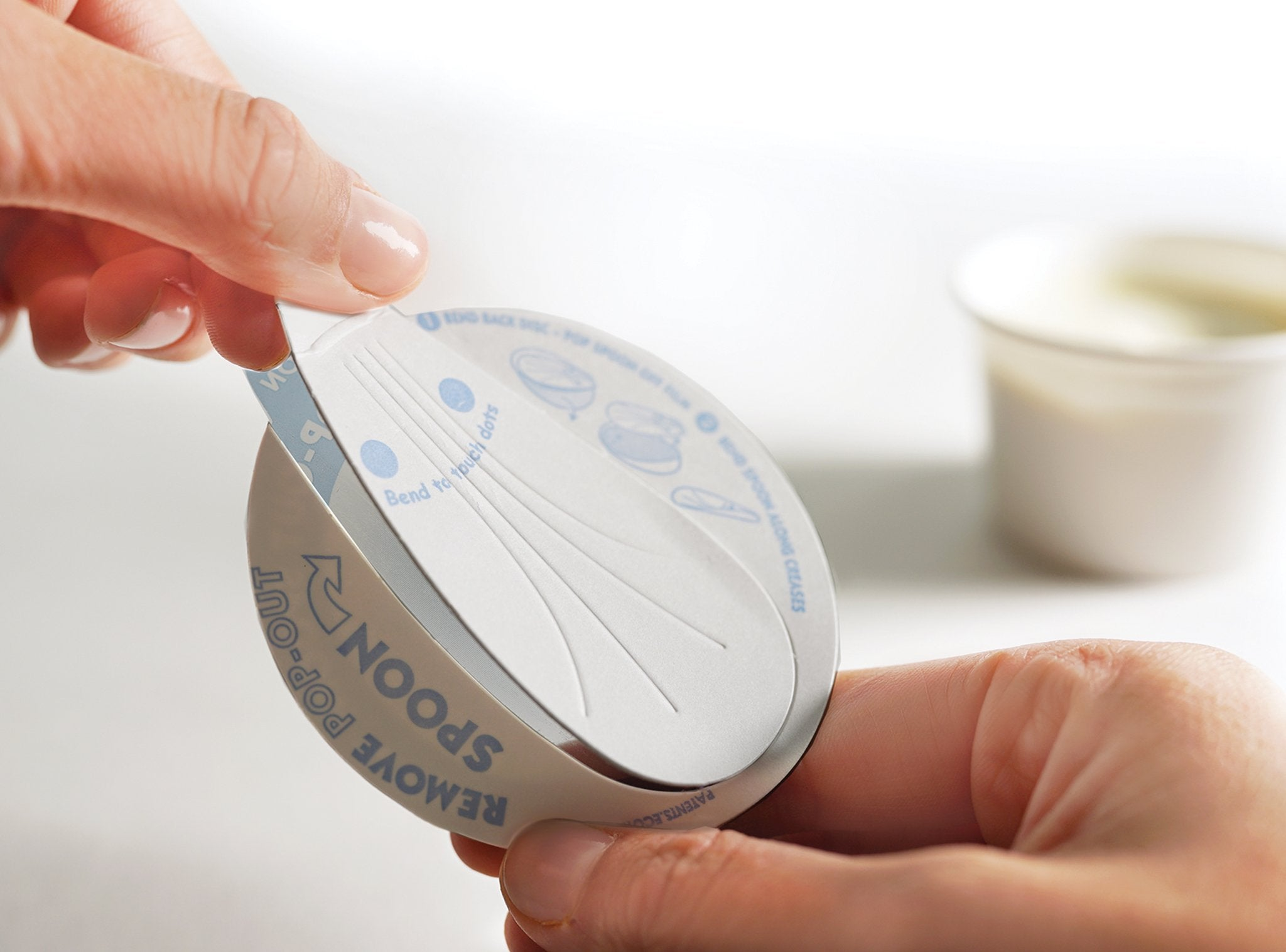 EcoTensil develops yogurt pot lid with pop-out paperboard spoon