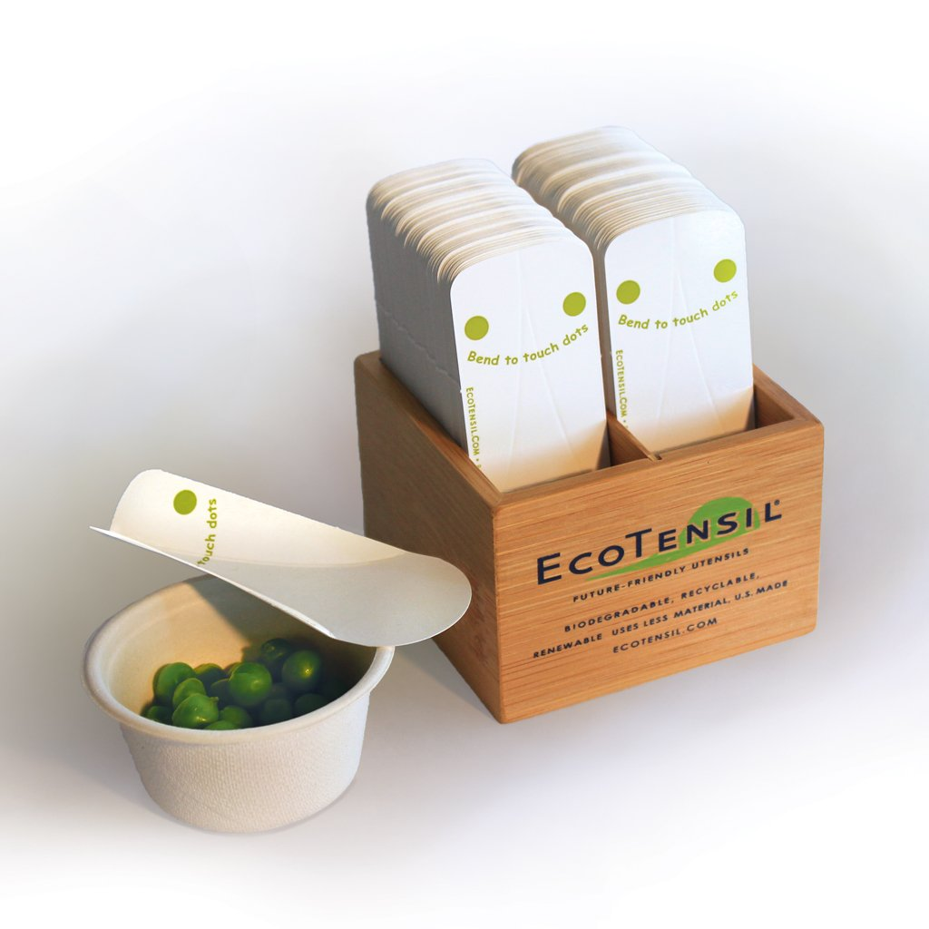EcoTaster Mini Starter Kit shown with a cup of peas and comes with 1,000 Compostable mini sampling spoons and a bamboo dispenser.