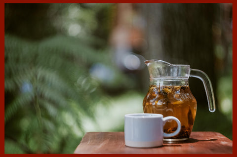 Darvaza Tea | Travel in a tea cup | jug of iced tea with a cup on a table