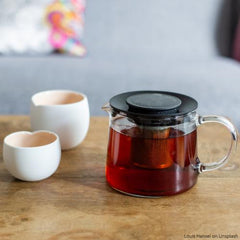 Darvaza Teas | Tea pot and cup on a low table