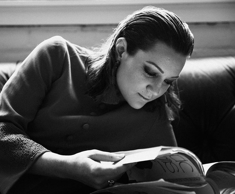 Nicolle Hodges reading a book