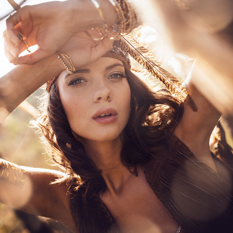 Beautiful brunette woman with fall fashion and flawless faux glow.